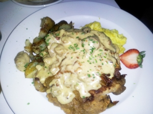 Chicken Fried Steak with two eggs scrambled, country gravy, smashed potatoes and toast